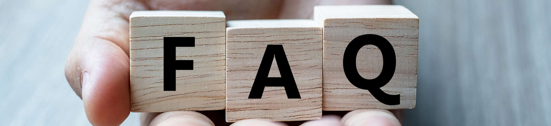 wooden blocks with letters that read FAQ